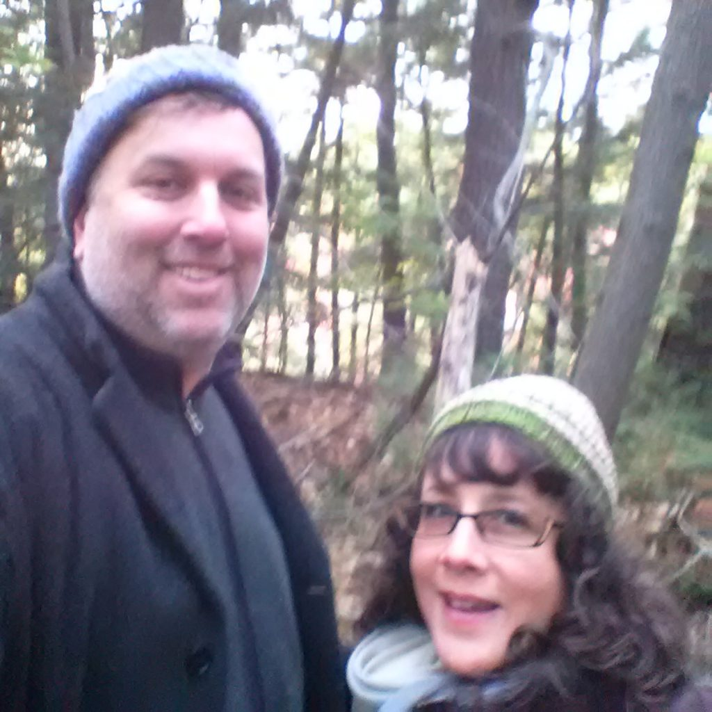 This image has an empty alt attribute; its file name is Tully-and-Kyra-in-woods-1024x1024.jpg